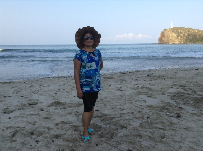 My mom posing at the beach before going up...